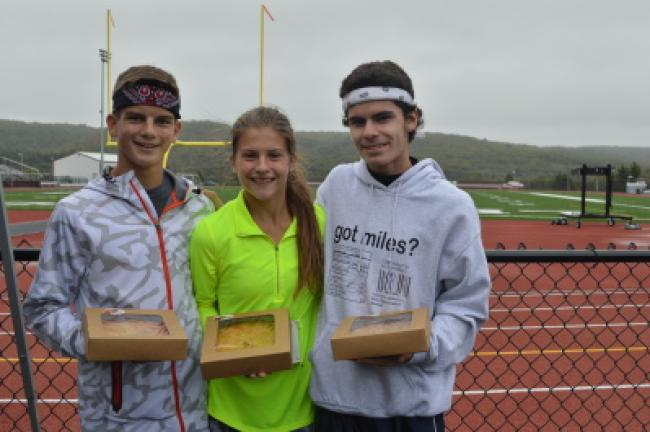 Nathan Lucykanish, Cera Gaston and Anthony Tavella hold their prize peach pies after finishing the first LEAF 5K.