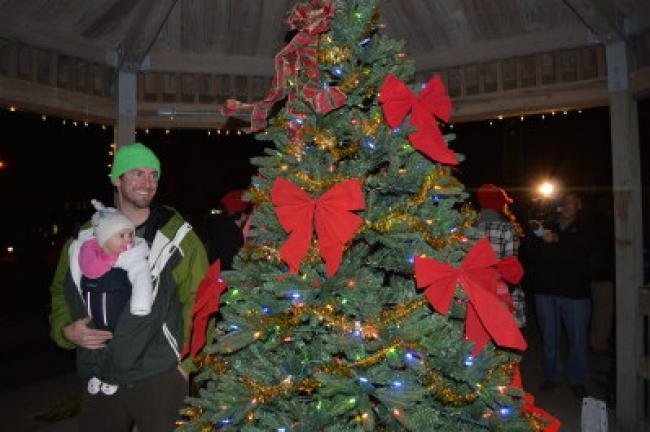 Tony Castagnera and baby Rory enjoy Slatington's tree in Memorial Park Friday night. KELLEY ANDRADE/TIMES NEWS