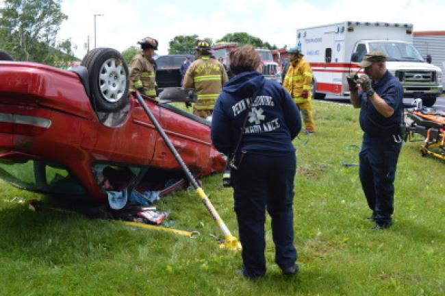 Megan Johnson volunteered to be the trapped motorist for the rescue demonstration at the West Penn Township CSI Camp at Commonwealth Connections Academy. KRISTINE PORTER/TIMES NEWS
