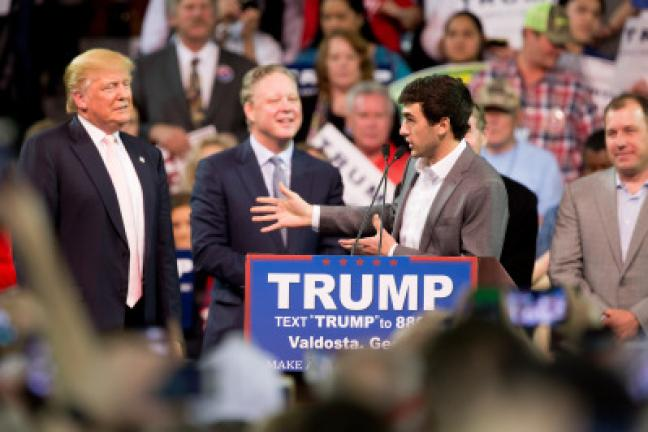 NASCAR Driver Chase Elliott, accompanied by Republican presidential candidate Donald Trump, left, and NASCAR Chairman and CEO Brian France, second from left, speaks at a Trump rally at Valdosta State University in Valdosta, Ga., Monday, Feb. 29,…
