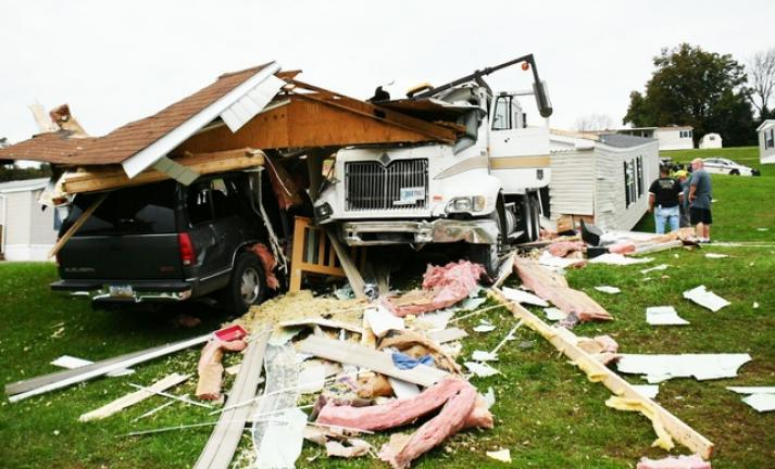8a8305ba34aec9 Truck slides into mobile home   Times News Online