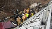 Firefighters from several communities spent hours Wednesday rescuing the trapped driver of a tractor-trailer in a crash along the turnpike in Penn Forest Township. COPYRIGHT LARRY NEFF/SPECIAL TO THE TIMES NEWS
