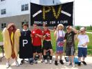 """ANDREW LEIBENGUTH/SPECIAL TO THE TIMES NEWS Seventh graders pictured during the relay, from left, are Mrs. Davis homeroom class Grant Lorkowski and Nick Mazzie dressed as a hotdog and pepper shaker to represent their class theme of """"Cooking For A…"""
