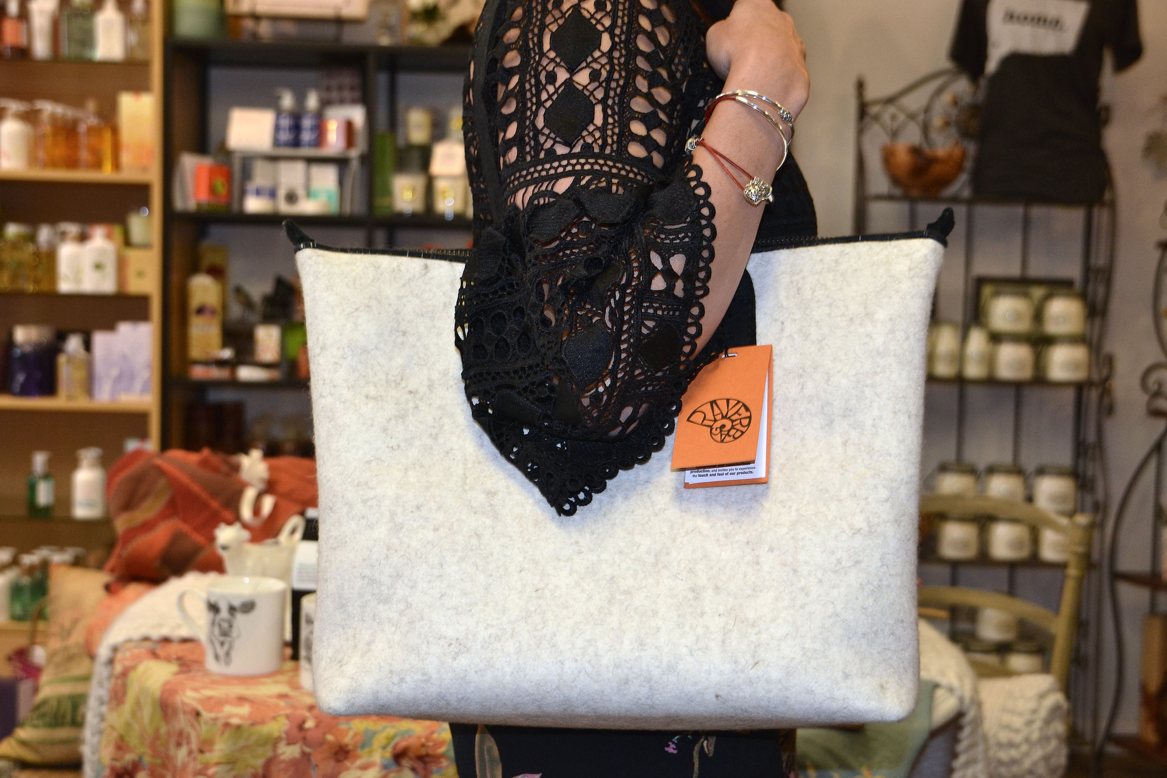 7f2f6042a1 Queen Street Gifts   Treats has a white tweed Rayerbag for those looking to  stand out from the conventional fall colors.