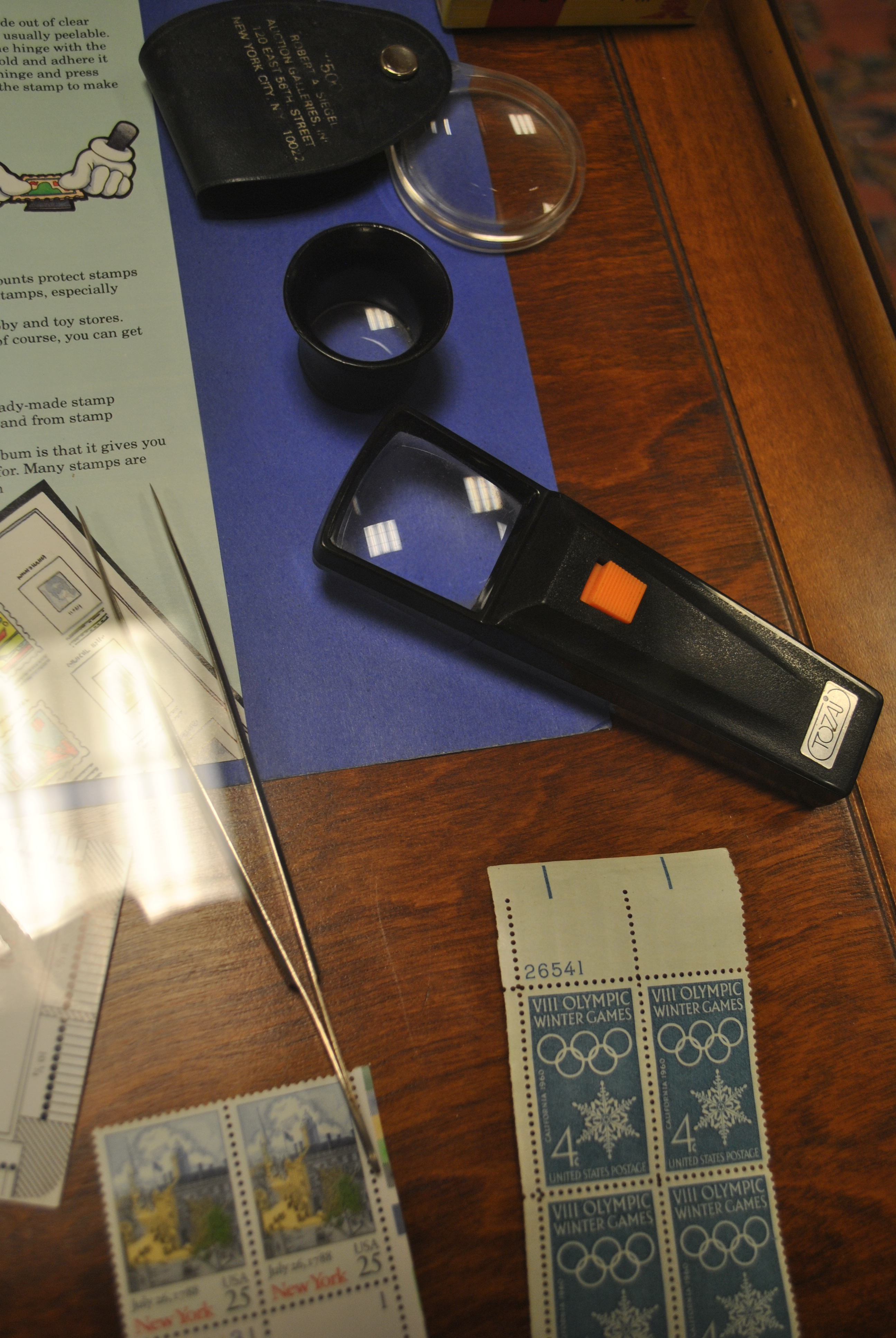 Magnifying Glasses And Other Tools Used By Stamp Collectors Are Part Of The Brookfield Philatelic Society Exhibit Now At CH Booth Library