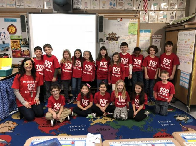 Middle Gate second grade teacher Bethany Phillips, front left, and her students are festively attired for the 100th day of the 2017-18 school year. (Kelley Michael photo)