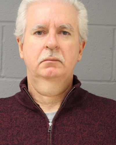 Newtown resident Douglas Russell turned himself in to police on December 17.  (Newtown Police Department photo)