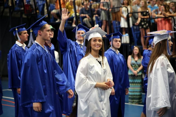 Newtown High School graduating senior Elle Sauli, center, looks around as she and her fellow classmates walk into Western Connecticut State University's O'Neill Center. (Bee Photo, Hallabeck)