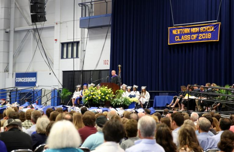 Newtown High School Interim Principal David Roach speaks at the NHS Class of 2018 commencement ceremony on June 18 at Western Connecticut State University's O'Neill Center. (Bee Photo, Hallabeck)