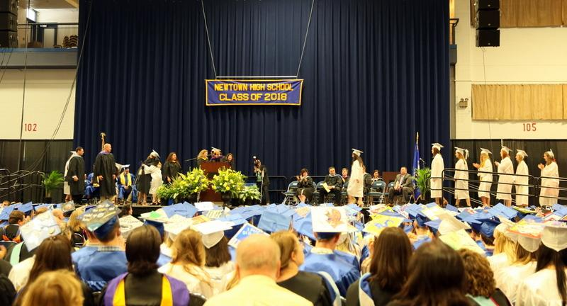 Newtown High School students walk across the stage at Western Connecticut State University's O'Neill Center during the graduation ceremony on June 18.  (Bee Photo, Hallabeck)