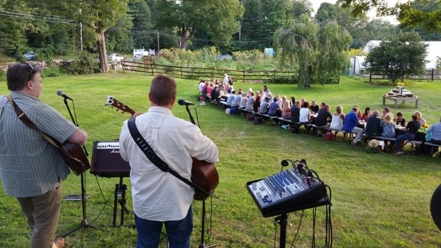 The Holbrook Farm outdoor dinners often feature live music as well as the freshest farm fare.
