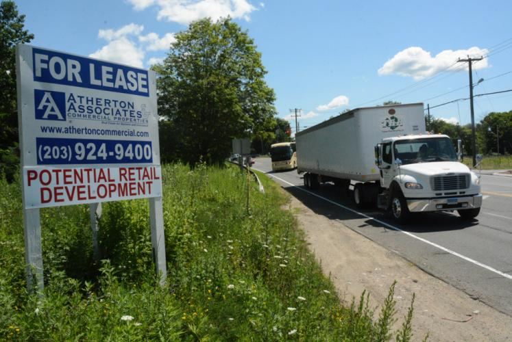 This view looks eastward along Church Hill Road toward the Exit 10 interchange of Interstate 84. The real estate sign posted at 75 Church Hill Road advertises the availability of leases at a potential retail development there.  (Bee Photo, Gorosko)