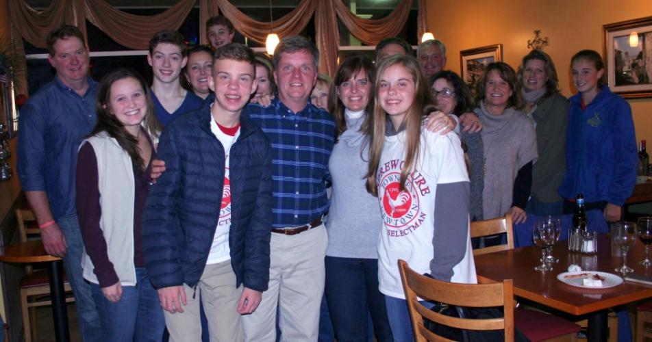 Petitioning First Selectman hopeful Andy Clure (center in plaid shirt) stands among family and friends at Franco's Pizza & Pasta, where they had gathered on Tuesday night to monitor election results.  (Bee Photo, Gorosko)
