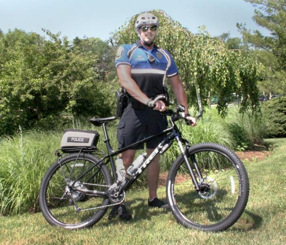 Police Officer William Chapman, who is a school resource officer at Newtown Middle School, also has become the police department's bicycle patrol officer. His patrols bring him to Fairfield Hills, Dickinson Park, and Treadwell Park, among other…