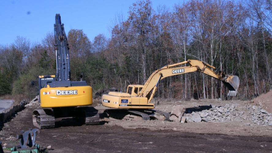 Multiple pieces of earthmoving equipment were at work midday on Wednesday, November 15, at a Church Hill Road site planned for a retail center. Workers have relocated a stream section on the property to prepare it for construction.  (Bee Photo, Gorosko)