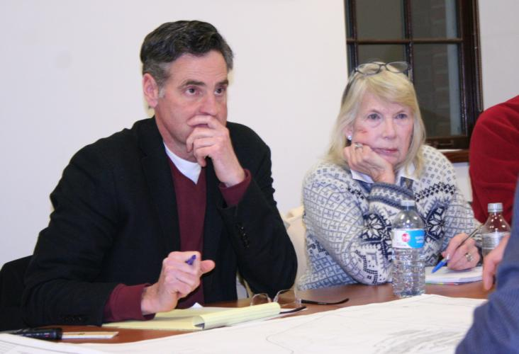 Design Advisory Board (DAB) Chairman Phil Clark and DAB member Kathy Geckle listen on February 5, as the developer of the proposed Hunters Ridge mixed-use complex describes the project's architecture and site design.  (Bee Photo, Gorosko)