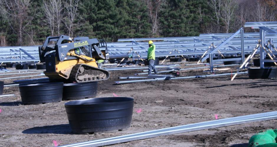 Workers were assembling a steel racking system at the closed town landfill, on November 28, that will hold several thousand solar/electric panels. When completed, the town will sell the electricity produced there to Eversource.   (Bee Photo, Gorosko)