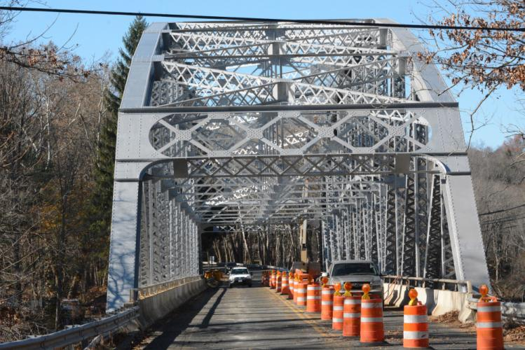 The intricate trusswork of the 308-foot-long Silver Bridge has been repainted, with the span again having a silvery color. Until recently, the bridge had been painted brown. The new paint job is part of an ongoing $4.47 million state renovation of…