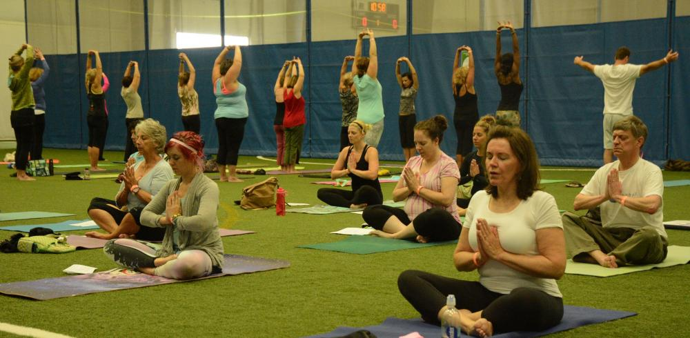 The Second Annual Newtown Yoga Festival held at NYA Sports & Fitness Center at Fairfield Hills on Saturday, August 23, attracted about 150 participants for a day of physical, mental, and spiritual discipline. Those seated in the foreground are…