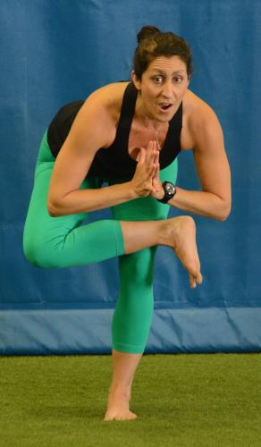 Yoga instructor Aline Marie demonstrates an alternate tree pose, a posture which requires discipline, flexibility, and poise to achieve and maintain.
