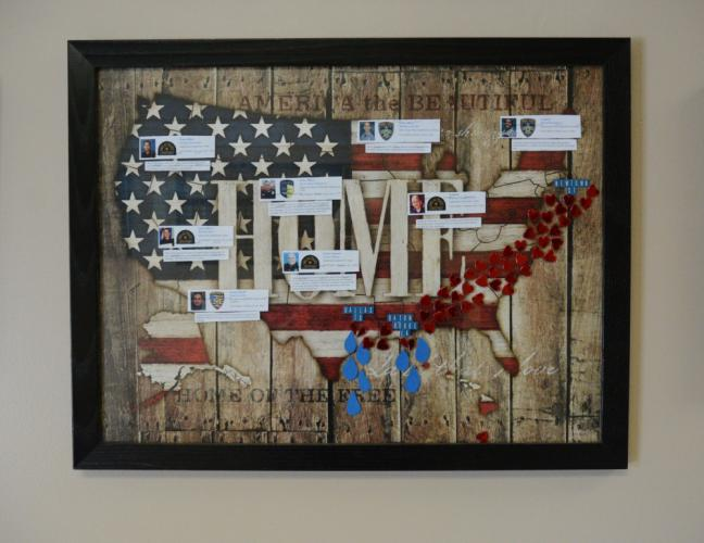 Newtown Police Officer Maryhelen McCarthy created this shadow box on display in the police station lobby that memorializes eight police officers who were slain recently in incidents in Baton Rouge, La., and Dallas, Texas. Tags affixed to the US map…