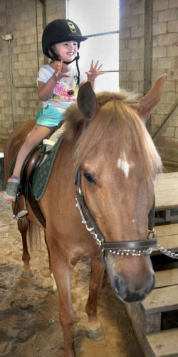Kayla Barrows rides a pony known as Andy at the 6th Annual Pony Rides for Jessica Rekos event.  (Bee Photo, Gorosko)