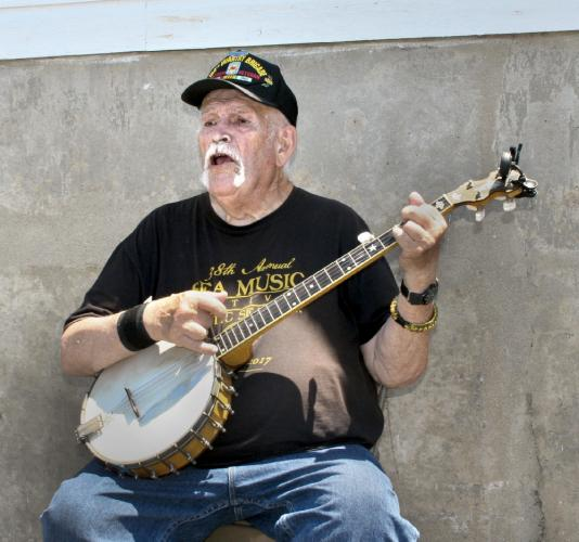 Don Sineti of Mystic Seaport sang and played banjo, performing a variety of folk songs and martime-themed tunes for those who attended the equine event at Fairfield Hills.   (Bee Photo, Gorosko)