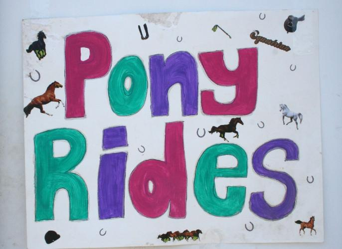 A colorful poster was displayed on the door to the arena where small children rode ponies at the Pony Rides For Jessica Rekos event.   (Bee Photo, Gorosko)