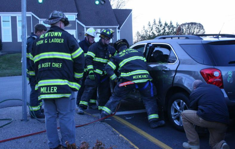 Volunteer firefighters worked to free a trapped motorist from a SUV following a collision that occurred about 3:05 pm on November 28, at the intersection of South Main Street and Mile Hill Road. Police said that a motorist, who was driving northward…