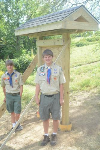 Daniel Reilly, left, is working on his Eagle Scout project, overseeing the creation of a kiosk at Newtown Forest Association's Nettleton Memorial Orchard. His brother, Conrad, right, recently did his project, overseeing the making of a storage shed…