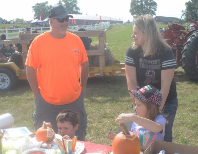 William Rose and dad Jeff Rose, along with Makayla Ile and mom Joanna Hoha paint pumpkins during the event. (Bee Photo, Hutchison)