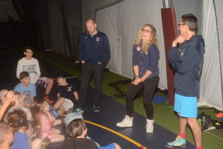 Olympic gold medalist wrestler Helen Maroulis gets a kick out of a question from one of the Newtown Youth Wrestling Association (NYWA) participants during a visit to the youth wrestling practice, at NYA Sports & Fitness, on February 19. Also…