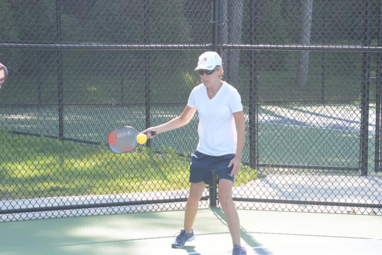 Mary Ellen Limato keeps the ball in play during a match at Treadwell Park. (Bee Photo, Hutchison)