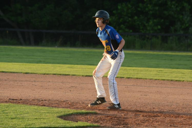 Chad Argraves leads off first base during the state tournament. (Bee Photo, Hutchison)
