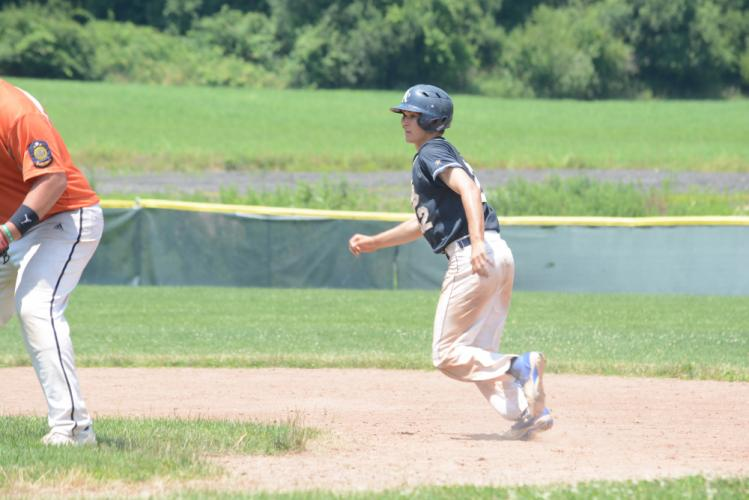 Will Huegi runs the bases during action this summer. (Bee Photo, Hutchison)