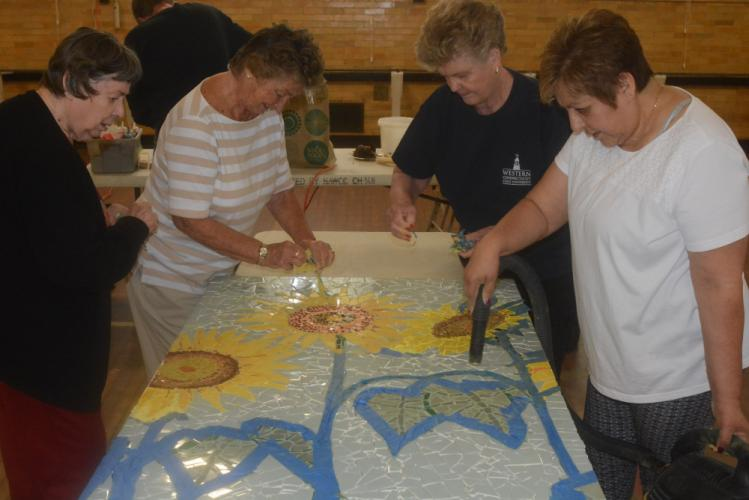 Volunteers who affixed tiles to panels to make a mural for the new senior center are, from left, Shirley Kopnicky, Pat Armstrong, Joanne Albanesi, and Mary Hanlon. (Bee Photo, Hutchison)