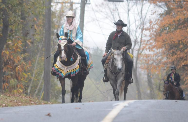 Beth Henvy, left, and Ed Prybylski, of Happy Trails Farm, ride during the NBLA's Frost on the Pumpkin Hunter Pace. (Bee Photo, Hutchison)