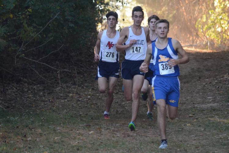 Ryan Escoda leads a pack of runners during action earlier this season. Escoda was Newtown's fastest to finish in the State Open. (Bee Photo, Hutchison)