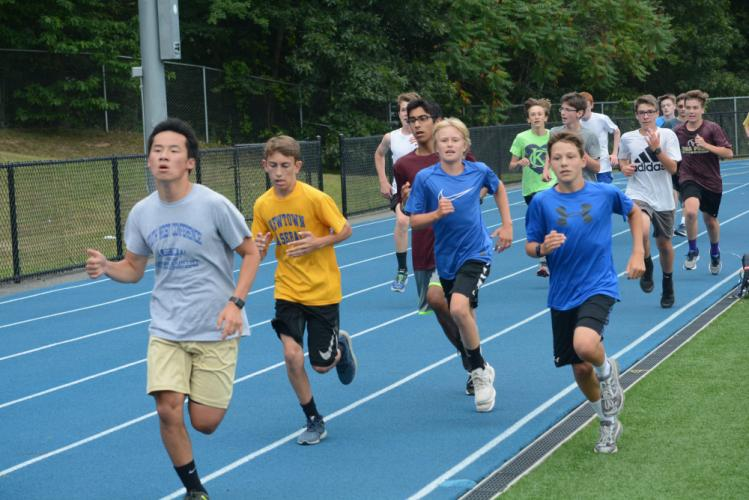 The Hawks warm up on the Blue & Gold track. (Bee Photo, Hutchison)