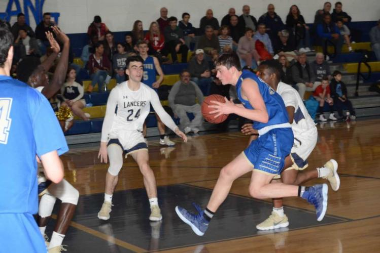 Robert DiSibio drives to the rim. DiSibio did most of his damage from the outside, hitting five 3-pointers in the win. (Bee Photo, Hutchison)