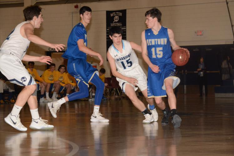 Nick Weiland dribbles as Todd Petersen gets into position during Newtown's win over Wilton. (Bee Photo, Hutchison)