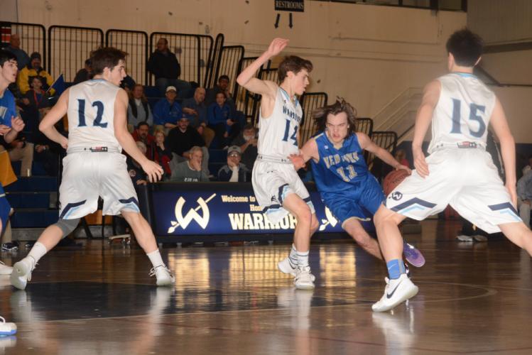 Riley Ward drives toward the basket. (Bee Photo, Hutchison)