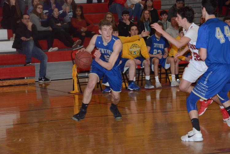 Evan Eggleston drives baseline for two points. (Bee Photo, Hutchison)
