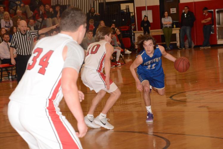 Riley Ward makes a move toward the hoop. (Bee Photo, Hutchison)