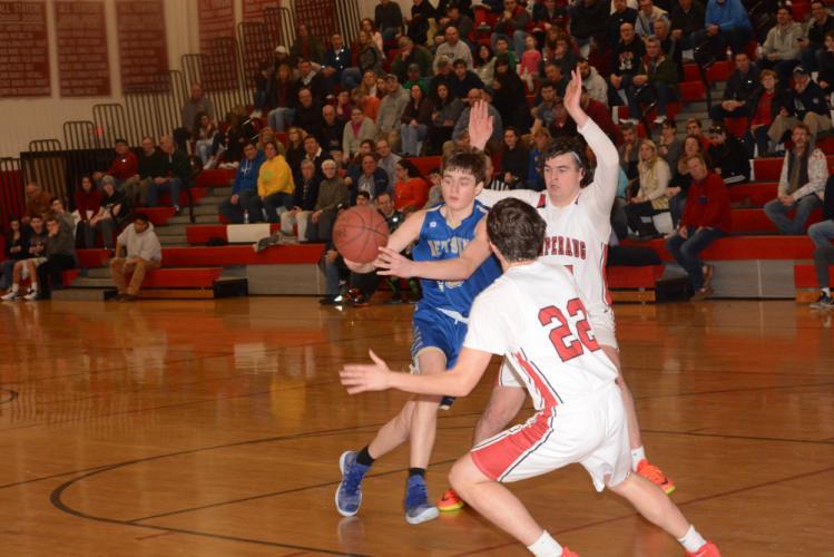 Robert DiSibio kicks the ball out as he drives toward the basket. (Bee Photo, Hutchison)