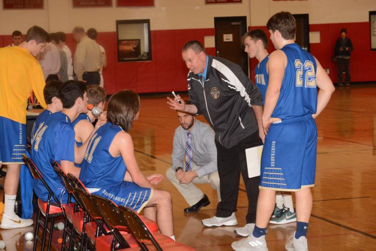 Coach Tim Tallcouch addresses his team during a timeout. (Bee Photo, Hutchison)