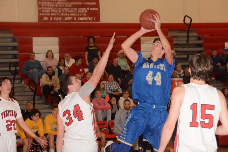 Todd Petersen goes up for a basket during Newtown's state playoff second-round win at Pomperaug. (Bee Photo, Hutchison)