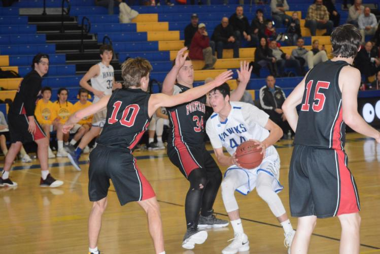 Todd Petersen works his way toward the basket during Newtown's loss to Pomperaug on February 9. (Bee Photo, Hutchison)