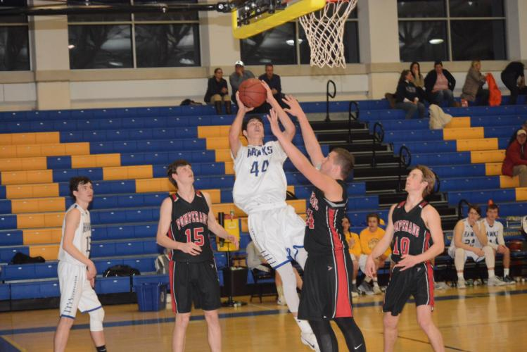 Todd Petersen competes during action this season. Petersen scored 19 points and had seven rebounds in Newtown's win over Stratford on February 20. (Bee Photo, Hutchison)