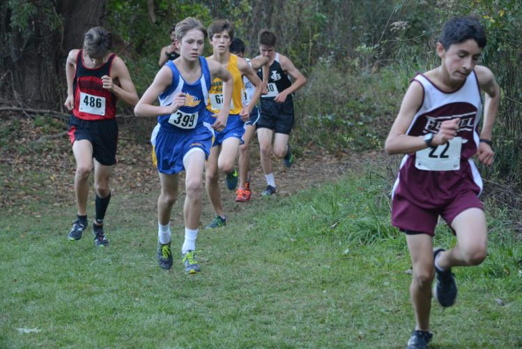 Jack Kuligowski and a group of runners are on the move. (Bee Photo, Hutchison)
